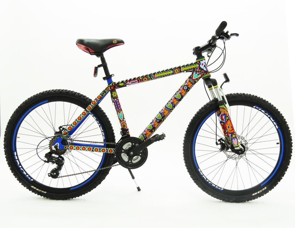 Bicicleta Monk Rodada 26 cuadro de aluminio finamente intervenida por maestros artesanos huicholes.